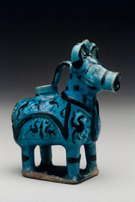 Aquamanile, turquoise with over-glaze design in black.