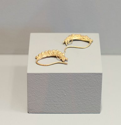 earrings; fish-dragon with floral motif on sides; repousse hollow gold, stamped.
