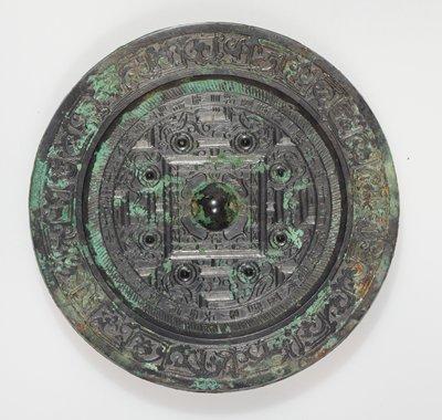 Mirror, round, black and green patina.
