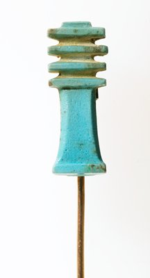 Pin, faience (brass), backbone of Osiris, symbol of stability, Egyptian, XXI Dynasty cat. card dims L. 1-1/16', W. 7/16'