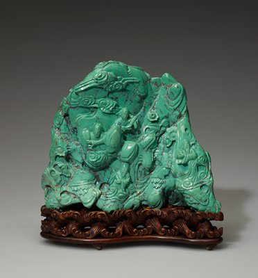 Carving in the form of a mountain. Buddhist dieties stroll or converse in a wooded mountain landscape.