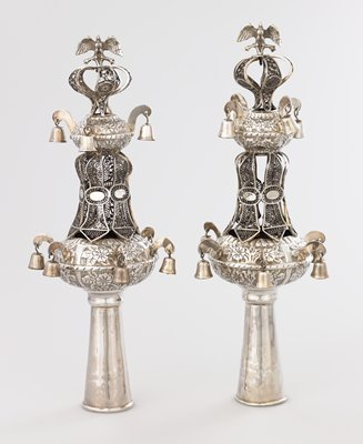 lobed design with 5 bells on bottom lobe, 4 bells near top; central filigree decoration; floral designs on lobes; openwork crown topped with bird