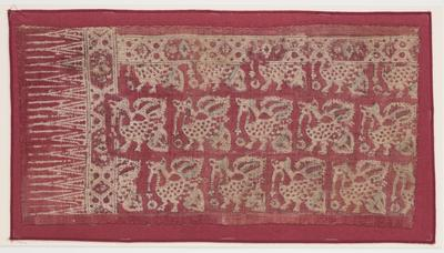 resist and mordant dyed, handspun and woven cotton; alternating rows of bird motifs; tan, pale green, maroon; triangular zigzag elements at left; floral motif bands at top and left; mounted to maroon backing