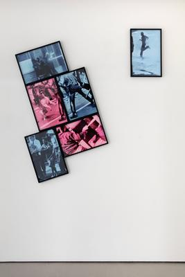 group of six framed photographs installed with one vertical photograph at right and five photographs clustered together at left at a 45-degree angle; each photo printed in black on blue or pink ground with Ben Day dots and framed in black frame Part 1/6 (a): blue; silhouette of running man in profile, wearing a hat Part 2/6 (b): pink; barking aggressive German Shepard dog on its hind legs with arm and leg of man being lunged at by dog at right; crowd at top of image Part 3/6 (c): pink; image on the diagonal; back of torso and PR arm of man swinging a bat Part 4/6 (d): blue; image of back of man with legs wide apart (head out of picture plane) with a dog pulling on the seat of his pants; other figures at top Part 5/6 (e): blue; image of a Black handcuffed woman wearing a dress and white shoes being pulled by her wrists by a uniformed figure and escorted by two other white men in uniforms Part 6/6 (f): blue; two Black men and a Black woman leaning against a brick building while a strong jet of water is strayed at their backs