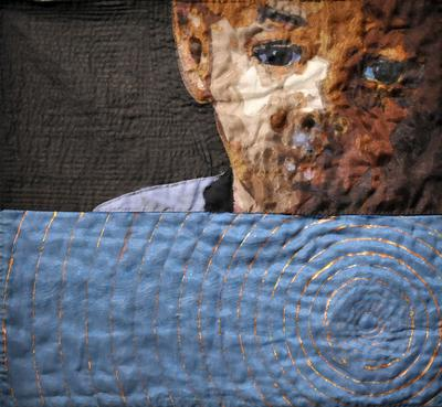 """image of a child's face in UR corner with a black ground; lower half is blue ground with metallic rings in a """"bulls eye"""" pattern; two metal loops in upper corners on verso for hanging"""