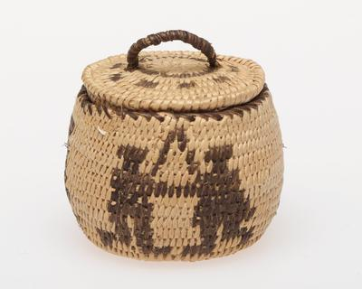 Miniature round basket with cover; coiled. Design consists of three pairs of dancing people. Colors are natural and black.