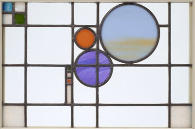 clear glass panels with 3 circles (blue, yellow and tan streaked with white); rectangles and squares in light blue, turquoise, green, orange and yellow; received mounted in wood frame with 98.256.6.2