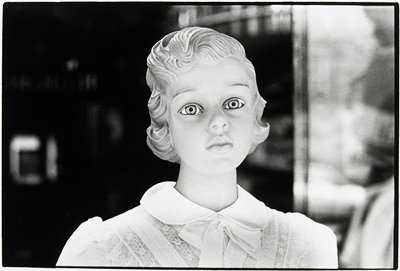 head and torso of doll with large eyes