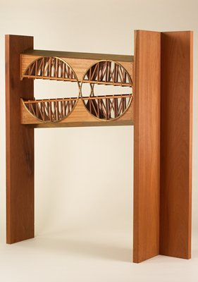 """v-shaped double """"skyway"""" with 2 connecting brass circled incorporated design; plexiglass """"windows"""" with wood supports"""