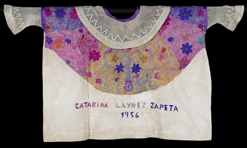 purple, pink and yellow embroidery with floral motifs; lace and netting attached at sleeves and collar; appliquéd ribbon above lace on sleeves and collar