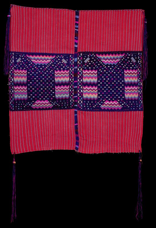 two red panels with light blue stripes, sewn together; predominately purple designs, with X's, circles and zigzags; long purple tassel at each corner