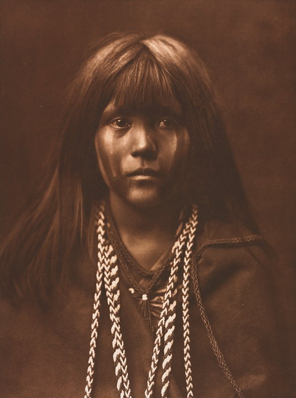 straight on portrait bust of Native American; long hair; bangs; face painted with four vertical stripes