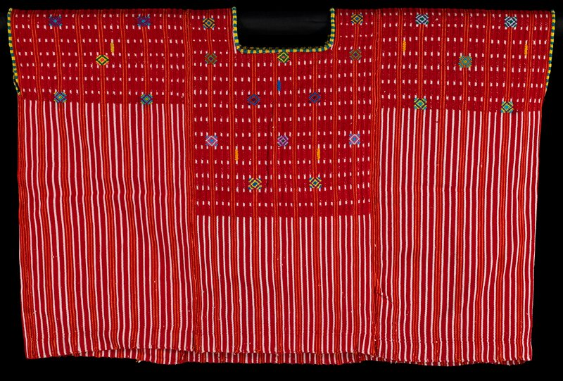 red, white and orange stripes; neckline and arm openings trimmed with turquoise and yellow thread; brocaded designs on top of radiating diamonds and small vertical bars in various bright colors