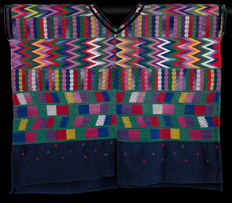 indigo; woven on top three-quarters with bands of multicolored various geometric patterns separated by green bands; small dots of various colors below bands; two rows of black velvet ribbon trim at neck and arm openings