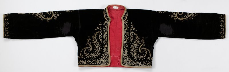 short jacket with long sleeves; dark purple velvet; lined with red; gold couching on front, back, cuffs and tops of sleeves
