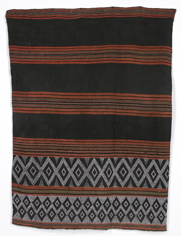 tube skirt; horizontal stripe bands in brown rust, tan and grey alternate with solid brown bands; bottom two bands have white beads woven into brown bands in diamond and triangle motifs