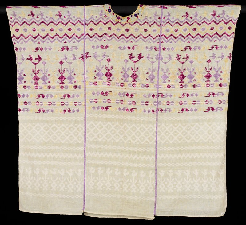 cream-colored, woven with subtle white designs on bottom of birds on flowers, diamond grid, zigzags and blocks; top woven in purple, magenta and yellow with flowers, zigzags, birds and geometric designs; embroidered rounded neckline in yellow, mint green, dark blue, purple and magenta