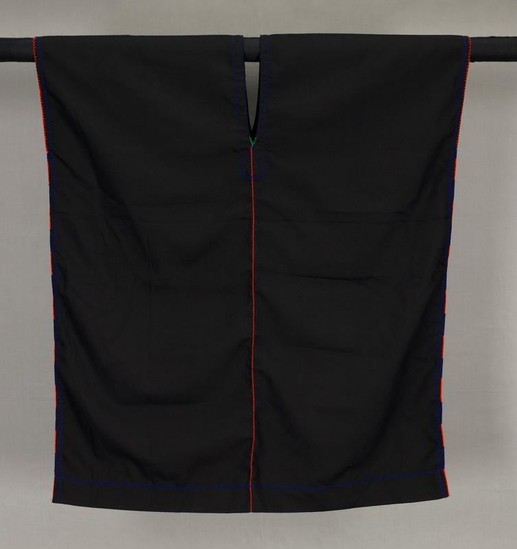 tunic-style; sleeveless; V-neck, front and back; black; line of vertical orange stitching down front and back; alternating orange and blue stitching at side seams, flanked in blue; orange stitching around sleeve openings; blue stitching at bottom hem and around neckline; green V stitching at bottom of neck opening, front and back
