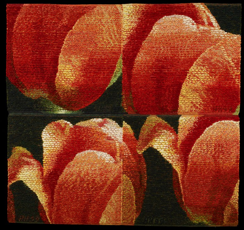 two horizontal panels stitched together; four red, orange and yellow tulip blossoms on a dark green ground; black heading band on back