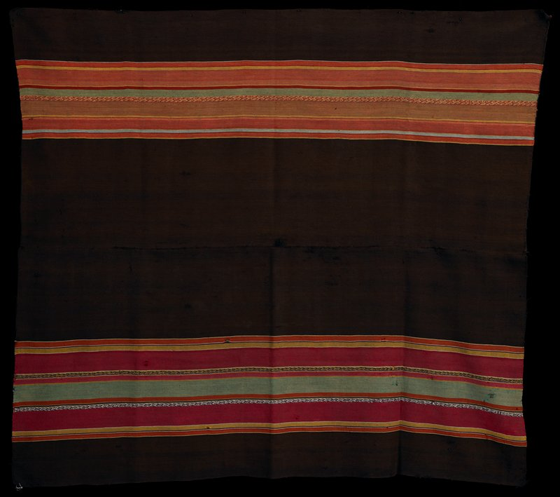 two pieces sewn together; each piece has two wide brown stripes flanking central row of multicolored stripes (predominantly red, orange and yellow) of various widths-one panel has wider rows of stripes; panel with wider colorful stripes has purple and white scroll patterned band and gold and purple scroll patterned band; other panel has red and gold scroll pattern band; warp faced plain weave with complimentary warp patterning