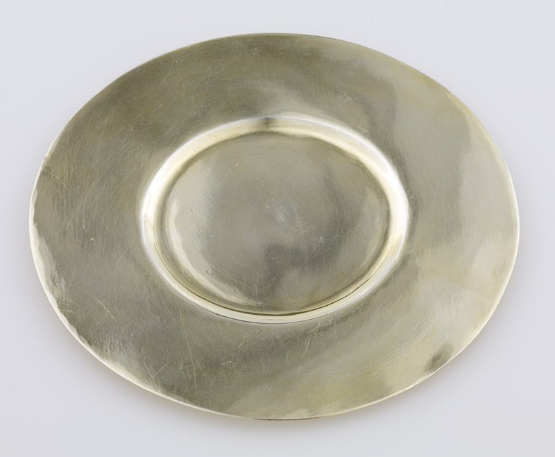 gilt saucer; tiny indentation at bottom center