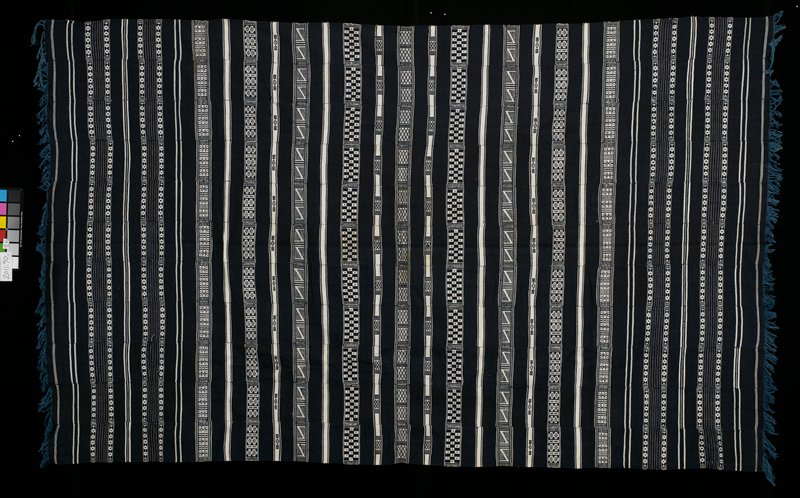 11 paneled, indigo blanket; black with black and white horizontal stripes; various geometric patterns in black and white stripes; fringe