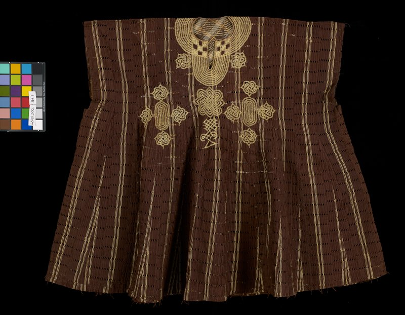 Man's tunic; brown, golden yellow embroidery; brown fabric with gold stripe; holes woven into fabric in horizontal stripes; rows of holes connected vertically with brown thread on surface; wide collar of gold embroidery; geometric motifs include knots, ovals and stripes; see pants L2010.200.165.2