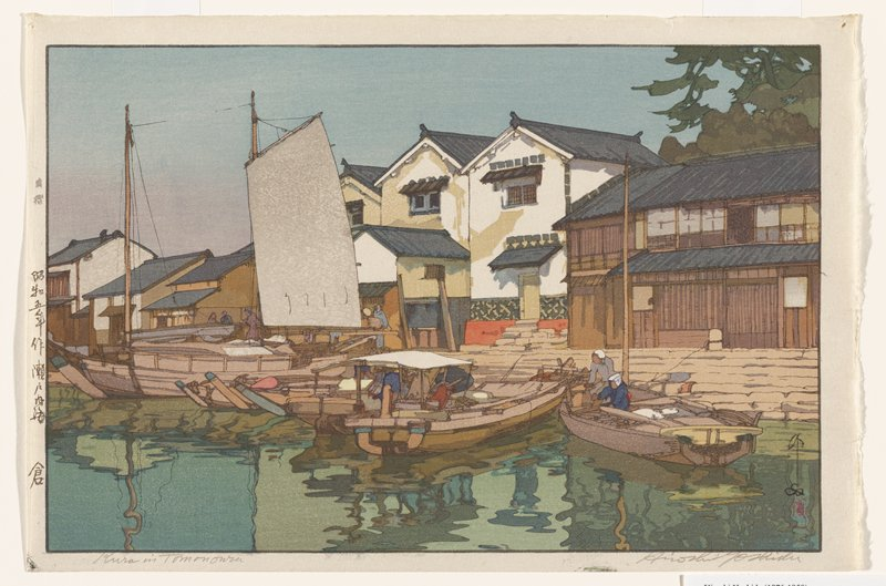 boats at a dock; sailboat at center left; buildings in background--brown buildings at right, white buildings at center; figures on boats and on dock
