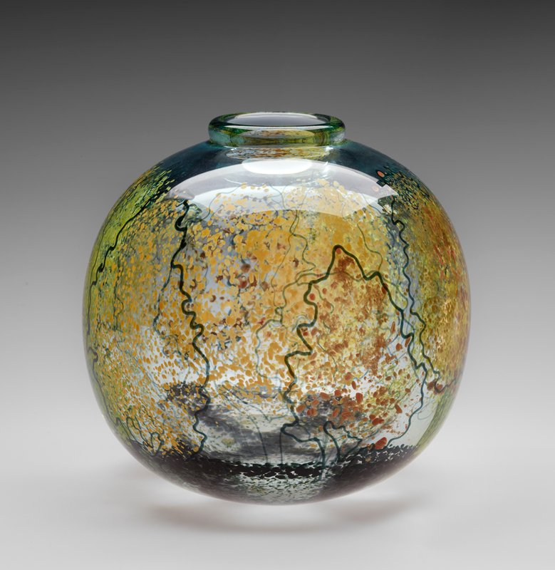 round bodied vessel with thick lip rim; clear glass with green tint; tan, orange and green trees