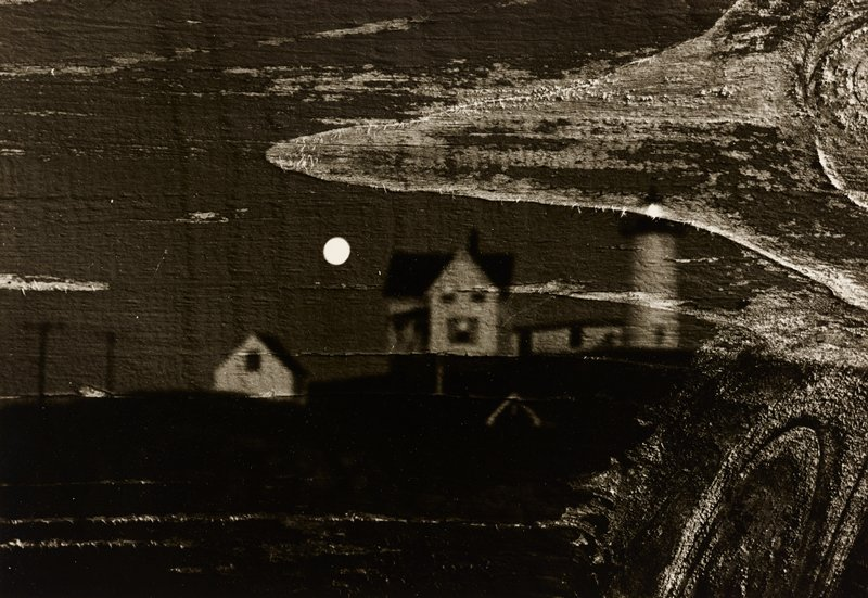 possible double-exposure; image of wood wall with knots and peeling paint with image of cottage and lighthouse, moon to left of cottage