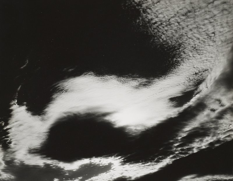 swirling patterns of clouds in sky