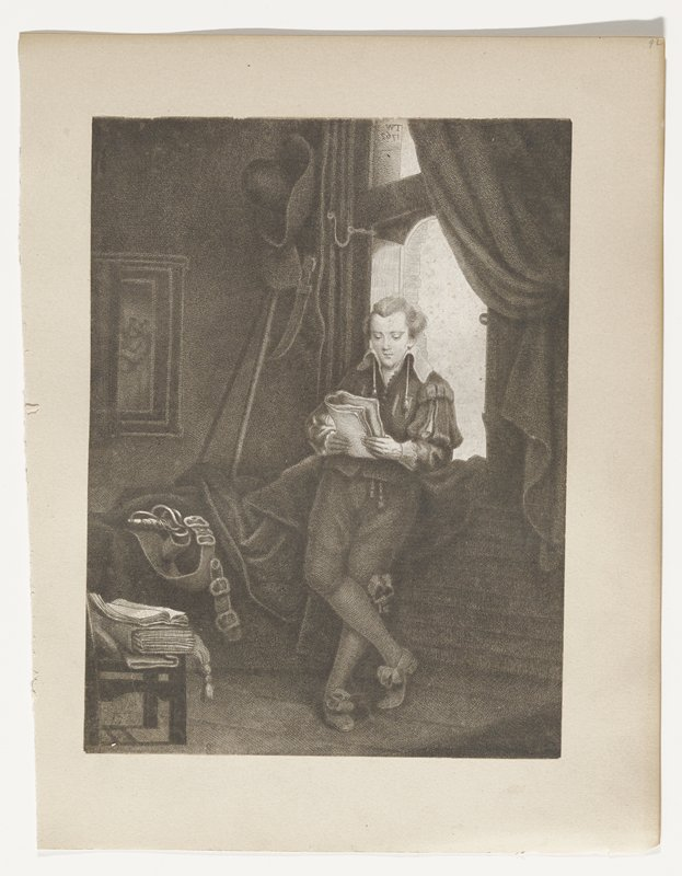 young man leaning against a window, reading; hat and large knife hanging at left; sword belt on bed(?); folios on chair, one open