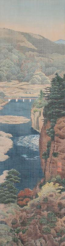 "image created with tiny squares of color in an overall grid, with white lines between squares; landscape with water at center with flat bridge, mountains and trees; trompe l'oeil painted mount with dark grey at bottom, light grey round image and bars of clouds in gold above and below image and similar vertical bars at top; two painted ""seals"" along right edge, LRQ; ivory roller ends"