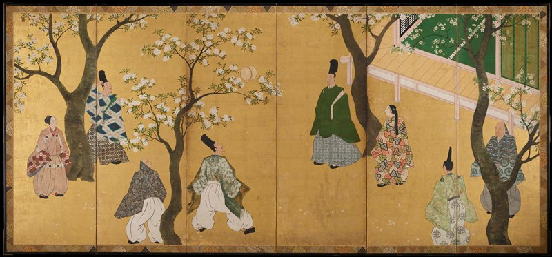 group of eight men and women playing a ball game within a copse of blossoming trees; ball is suspended in air near tree at center; portion of building with green screens and a verandah at R