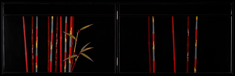 two-panel folding screen; thin, stylized red, gold, silver, and burgundy bamboo stalks against black background; small spray of bamboo foliage on L screen