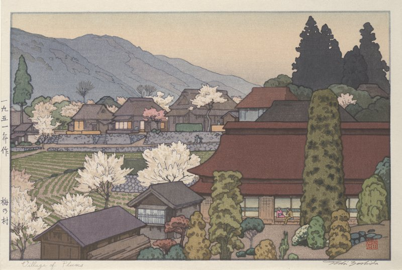 village scene with many blossoming white and pink plum trees; farmland in center; large building at LR with a man in tan suit and woman in pink kimono with blue obi sitting on verandah; green bushes and shrubs at LR; mountains in background
