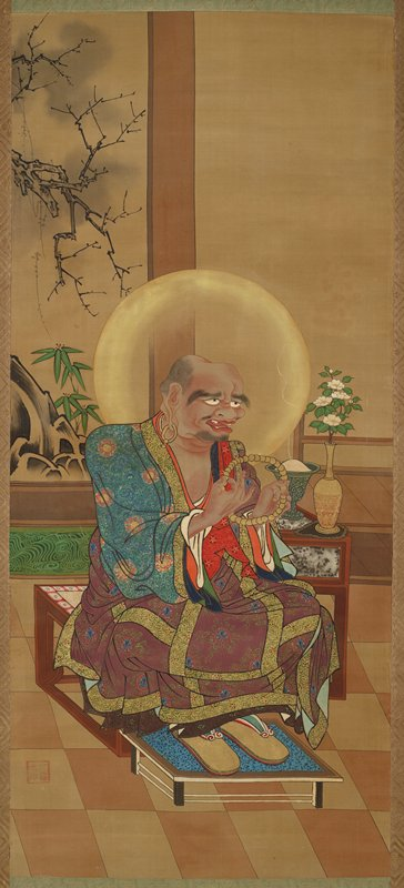seated figure wearing sumptuous purple, green, gold brocade robe; seated near center of image facing LR; holding string of gold rosary in both hands; exaggerated facial features, large eyebrows; several missing teeth; golden halo behind head; incense vessel and vase with flowers at PL; landscape of bamboo, a rock with cascading water, and a branch behind PR