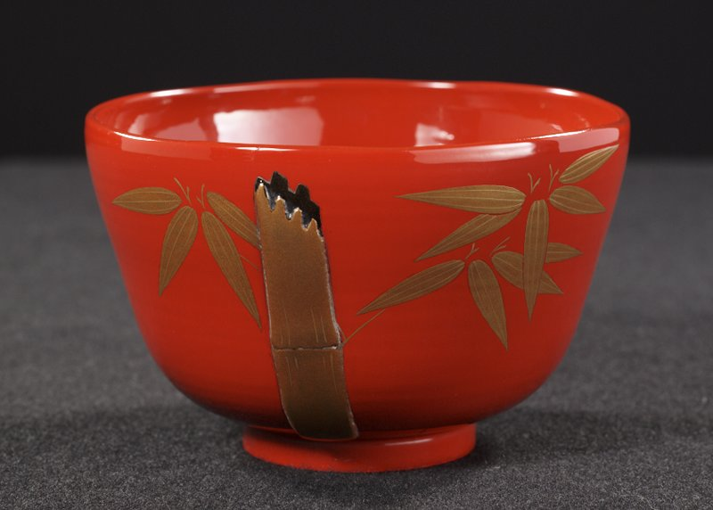 red lacquered bowl; broken bamboo stem design with leaves in gold