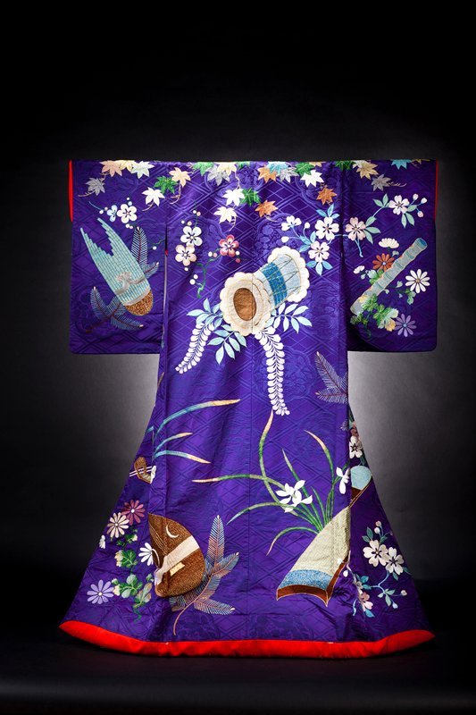 purple uchikake with koto, biwa, taiko and flower motifs
