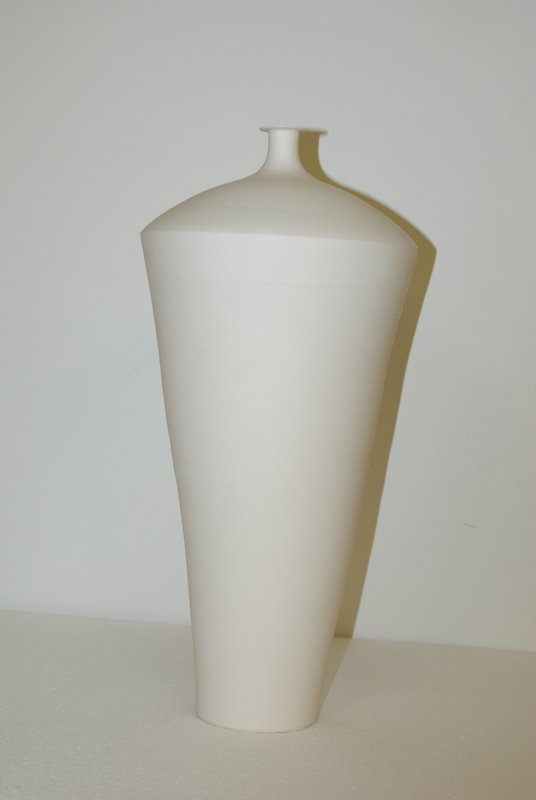 unglazed, white, cone-shaped vase with domed top; tall, narrow neck with flat lip