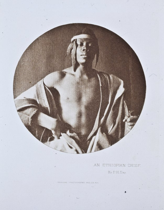 a man with headdress, robe, and staff looks outward; circular composition