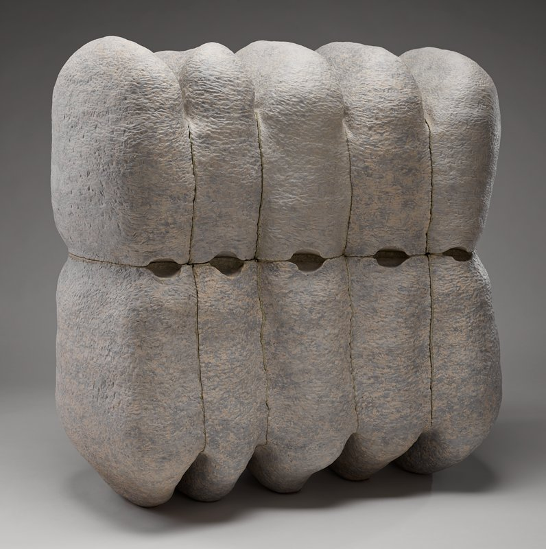 large sculpture with ten lobe pieces; grey and white dapple in color with a slightly textured surface