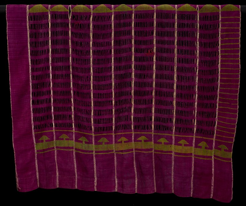 eleven strips sewn together; predominately purple with cream edging on strips and green arrowhead designs, stripes and bowtie shapes; openwork patterning in weaving with twisted threads