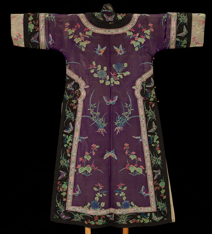 long-sleeved robe; body of purple sheer silk woven with multicolored plants, flowers, butterflies and insects; black sheer silk trim with similar muticolored weaving; pastel-colored additional trims with floral motifs; off-white cuffs and lining
