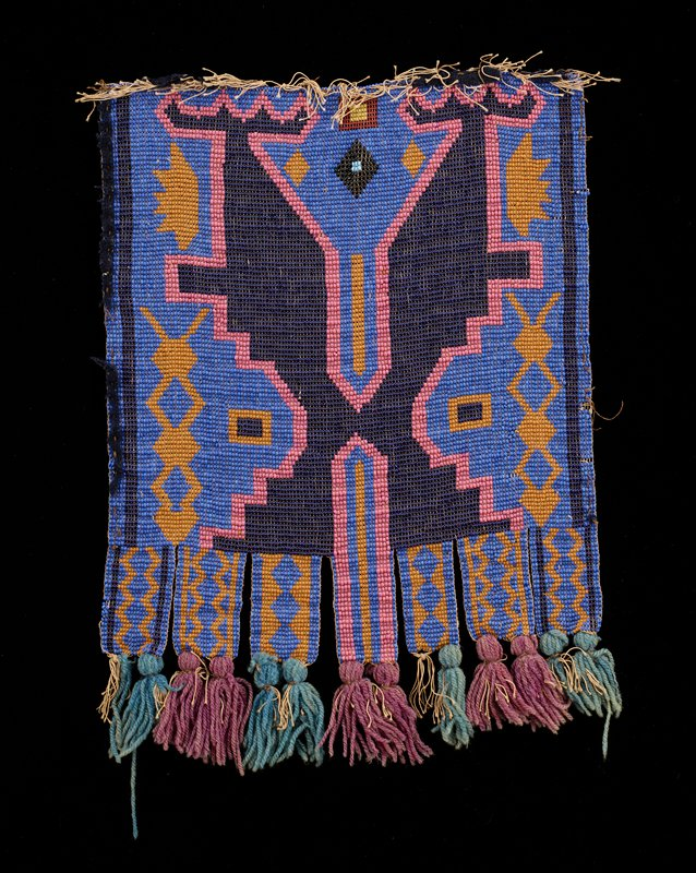 small beaded panel with beaded strips/tabs terminating in pairs of turquoise or light purple wool yarn tassels forming fringe; medium blue beads on ground, with symmetrical forms with steps and zigzags in predominately pink, golden yellow-orange and dark blue beads