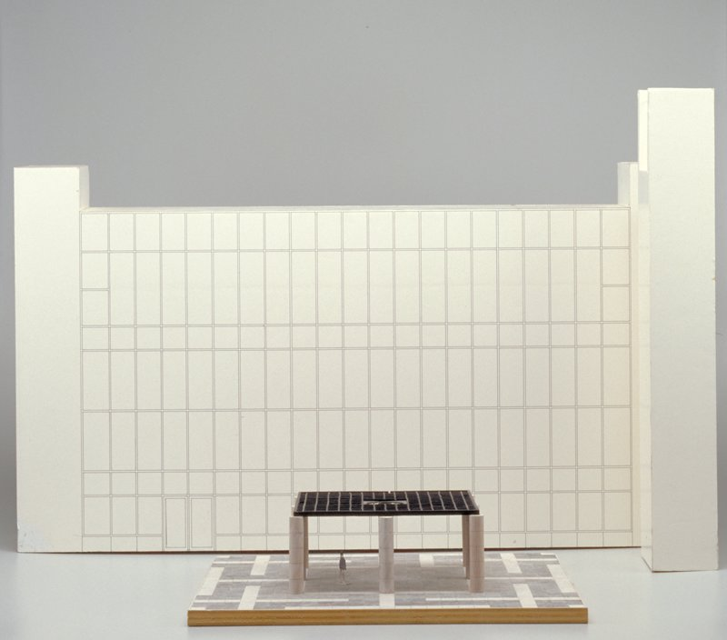 Model of pavilion with person inside; six small painted wood squares are completely removable; model of MIA glass facade with windows drawn in felt-tipped pen