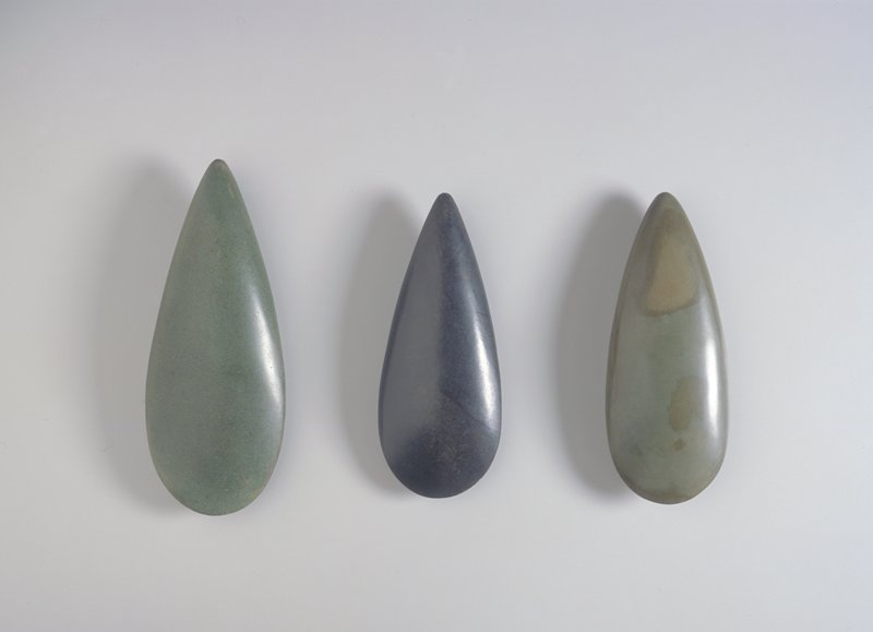 Teardrop shaped; green stone with brown blotches