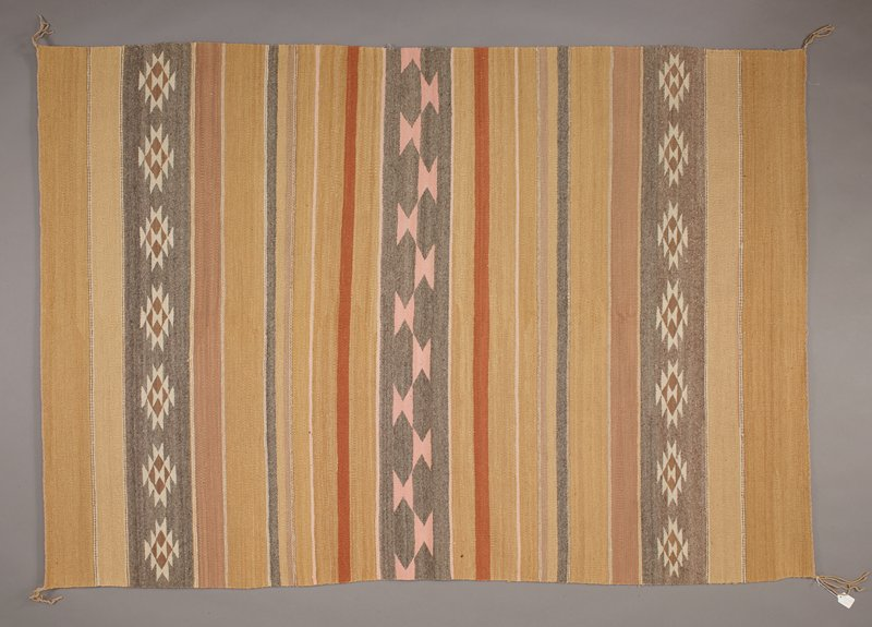 light and medium tan, light brown, white, grey, pink and rust red; plan stripes of various widths and colors; three patterned grey stripes--two with stepped white diamonds surrounding brown diamonds with two white triangle at center, one stripe with pink bowtie shapes