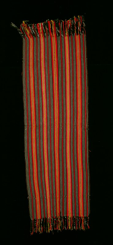 Two-panel huipil with randa; plain weave, white ground with multicolor supplementary weft patterning; pattern consists primarily of rows of birds with occasional rows of unidentifed form - possibly ceiba tree or urn with plant life; design predominantly red with yellow, green, blue, pink and purple accents multicolor embroidered neck.
