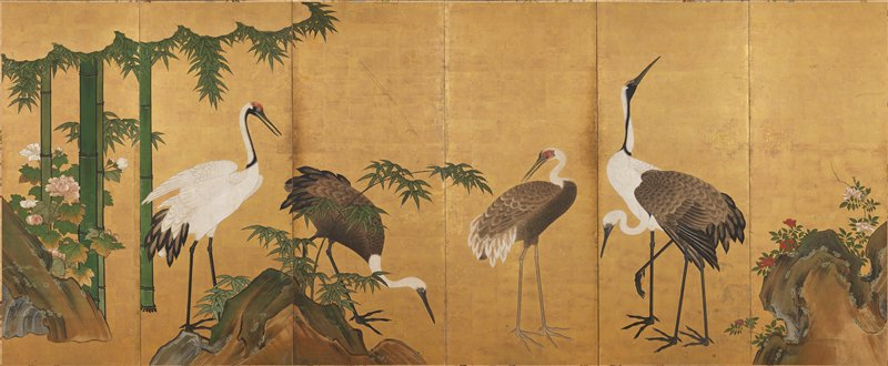 family of cranes; rocks at R with white and red roses; bamboo fronds and rocks along bottom; large bamboo trees at L with peony blossoms; gold foil background